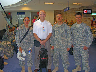 Photo of Stephen Butler with troops deploying to Irag
