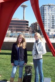 Flute in front of Seattle's space needle with puppy raisers