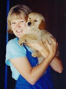 Suzanne Woods Fisher holding a baby puppy.