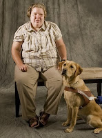 GDB graduate Alma Rodick sits with yellow Lab Guide Dog Shimmer