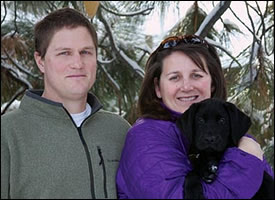 GDB puppy raiser Megan Minkiewicz and husband Alex with black Lab puppy-in-training Caleb