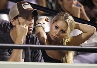 Photo of Anna Kournikova and Enrique Iglesias watching Williams sisters tennis match in Key Biscayne, Miami