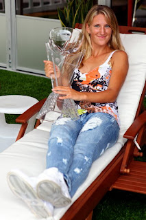 Photo of Azarenka posing off court with Miamia trophy