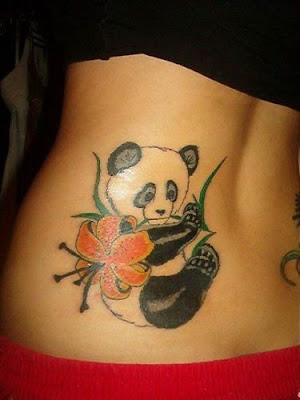 Female With Panda And Flower Lower back Tattoo Designs