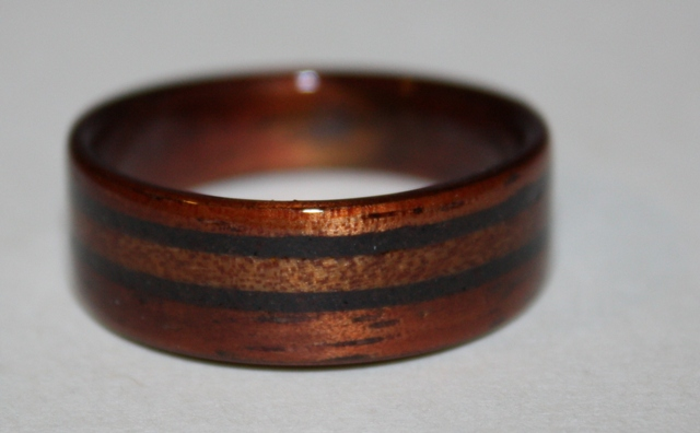 For Kevin 39s wedding ring they designed this dark Hawaiian Koa wood ring