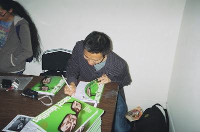 Jimmy J. Aquino signs a book. Photo courtesy of JJA.