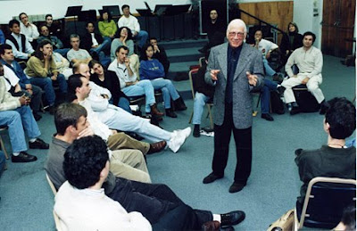 In this 1999 photo, Jerry Goldsmith tells a UCLA film music class that if you ever run into one of those record company execs who are responsible for those 'Music from and Inspired by...' collections of songs that aren't even in the movie, feel free to kick the shit out of him.