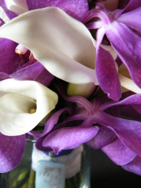 This bridal bouquet was made of purple Aranda Orchids white Calla Lilies