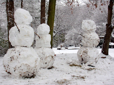 Images lifesize snowmen in my frontyard and my enchanted forest in the