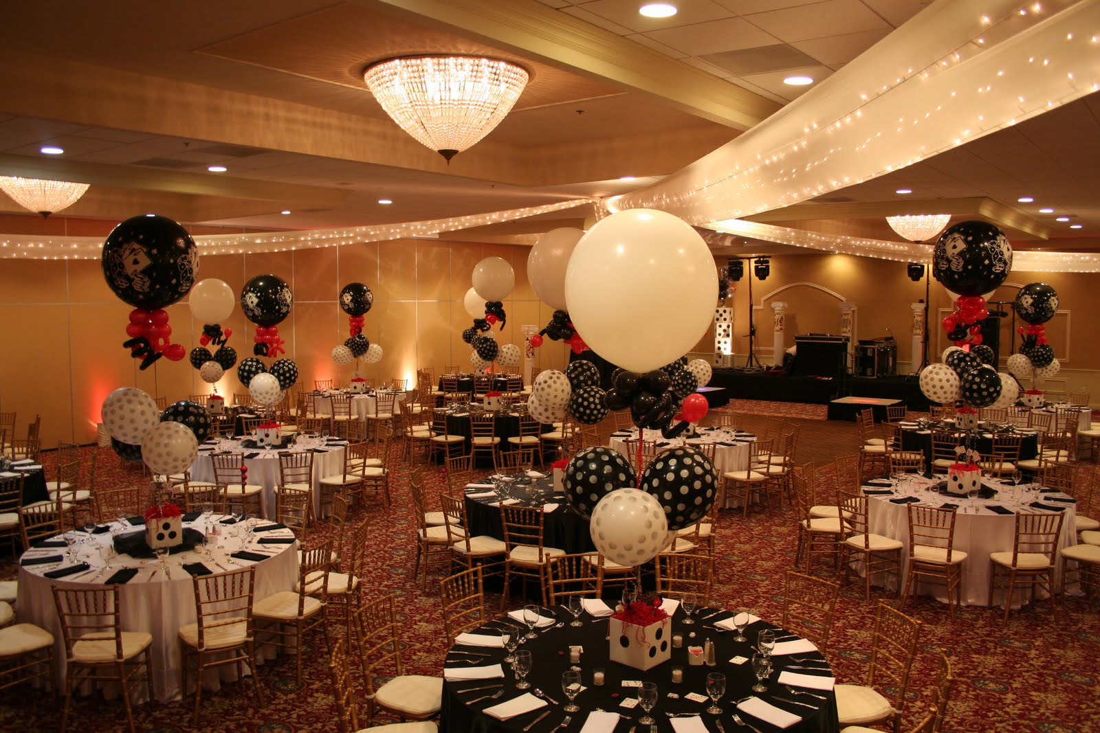 The room dazzled with red, white and black! Casino tables were brought  title=