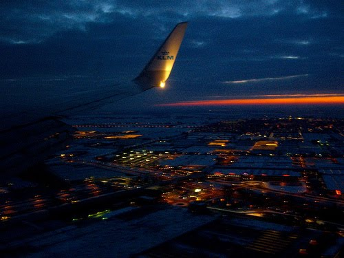 Flying over Amsterdam at sunrise.