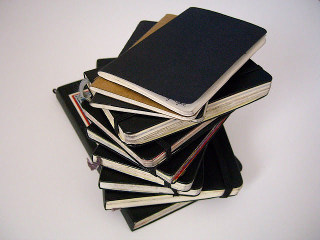Stack of Samantha Zaza's sketchbooks of 2009.