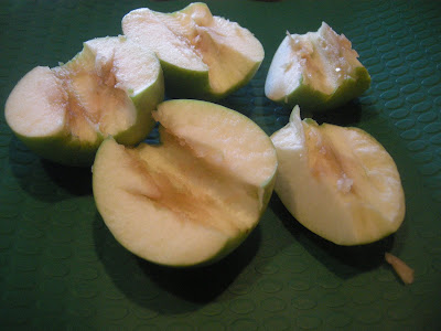 I sliced and cored two Granny Smith apples and put the slices on another ...