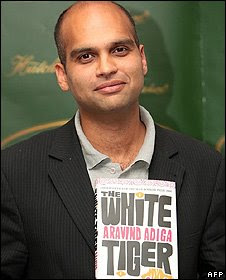 Aravind Adiga holding his Booker-prize-winner novel The White Tiger