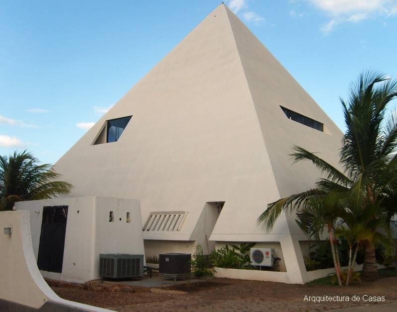 Arquitectura de casas residencia moderna con forma de for Construcciones modernas