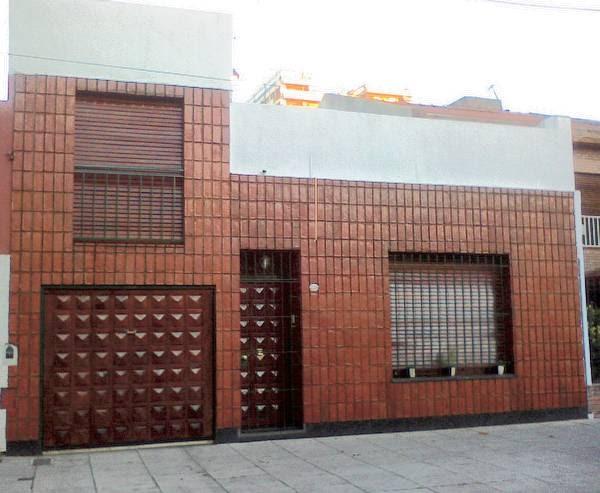 Arquitectura de casas fachada forrada de ladrillos - Fachadas ladrillo visto ...