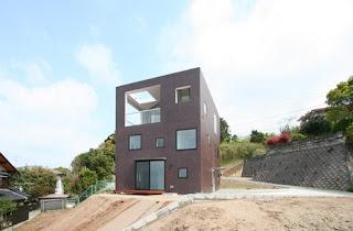 Casa cúbica japonesa contemporánea de hormigón armado