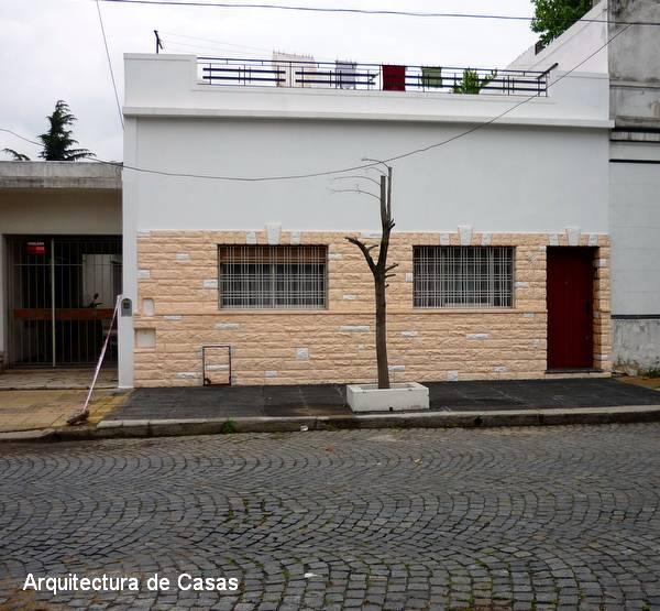 Arquitectura de casas pintura de fachada en casa de barrio - Pintura para fachada ...