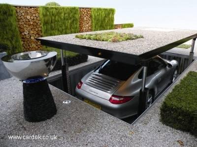 Arquitectura de casas garaje exterior con elevador de for Garajes para carros