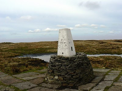 The trig point on Black Hill was rebuilt on a stone plinth to stop it from succumbing to the surrounding peat bog