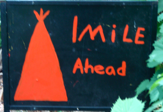 teepee one mile ahead sign