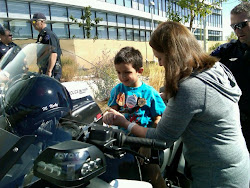 Mom helping Dj on the Police motorcycle