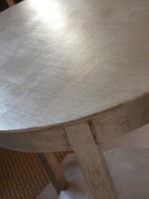 the silver leafed side tables