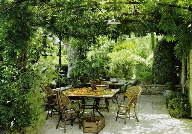 Iron pergola, lush outdoor living space Côté Sud, Aout-Sept 2006, as seen on linenandlavender.net