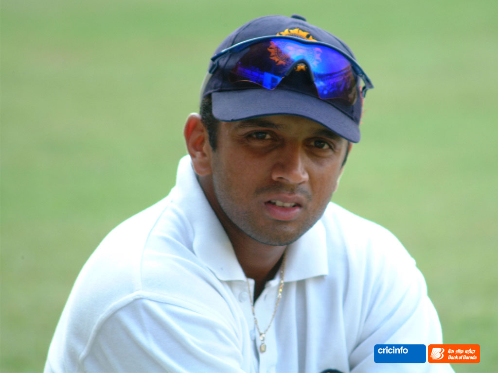 dravid2 1024x768 Tiger Fired Caddy Over Elin Affair