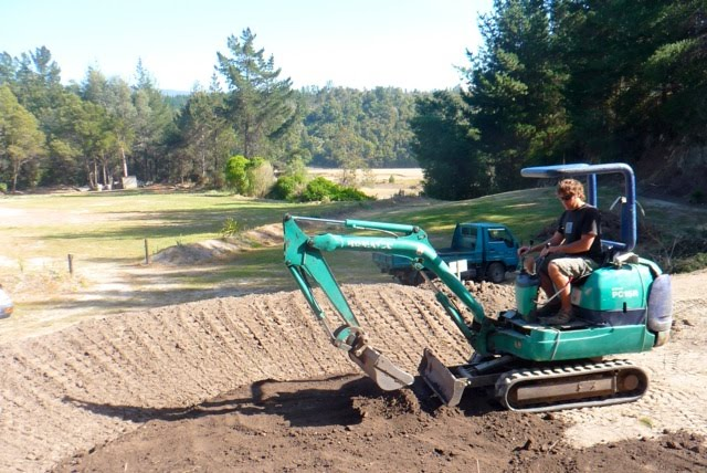 Building Backyard Pump Track :  , Karl moved in and started building & shaping the berms & rollers