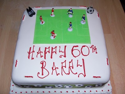 Football birthday cake for someone named Barry.