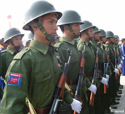 >fighting forces up to 30,000 to flee to China