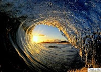 Beautiful sunset, seen through an ocean wave