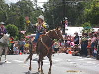 Coolest Cowboy Hui followed by Russ the Saddlemaker in the Makawao, Maui, Hawaii, Fourth of July Parade, 2009