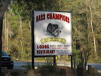 Click to enlarge - The sign out front you have to watch for to find Bass Champions.