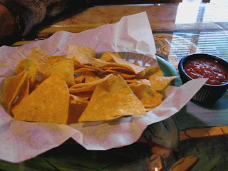 Warm tortilla chips and salsa