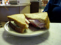 Click to enlarge -  Turkey sandwich with lettuce and tomato.