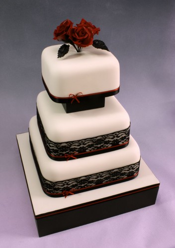 Striking red roses and black lace on white squares on a black base with