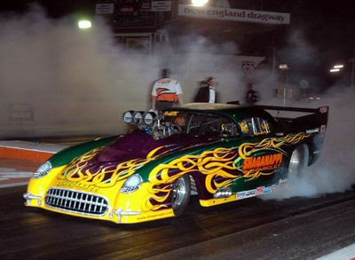 Auto Drag Racing on Drag Racing Is A Sport Wherein Two Cars Race Down A Defined Distance