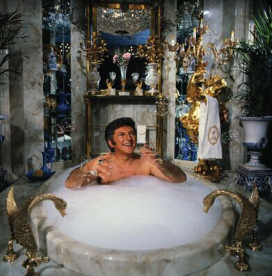 Liberace became a true superstar. He bought lavish mansions, remodeled them ...