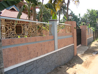 Picture shows compound wall in front side of Edappally house which is