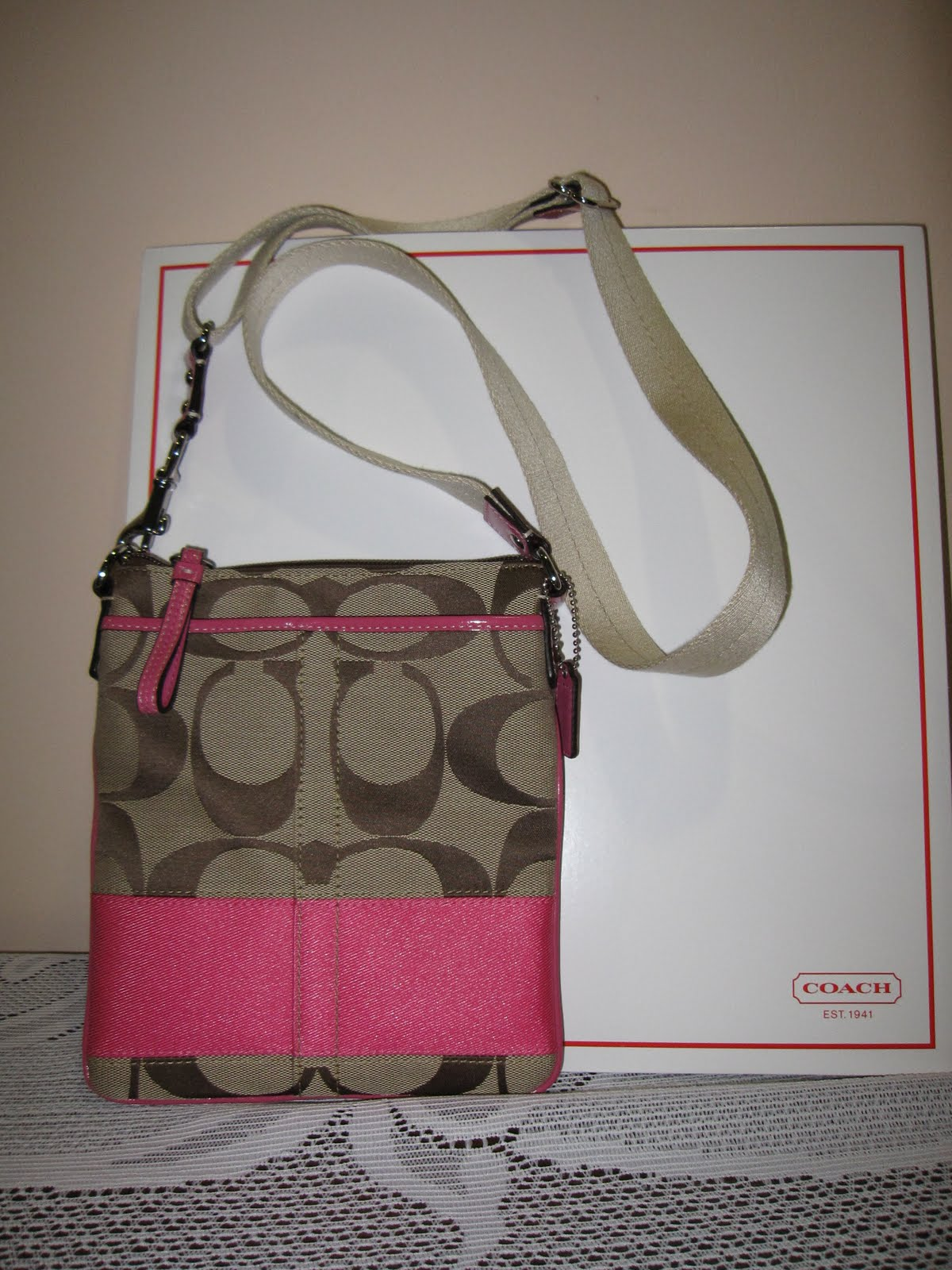 2181a1f524 SKHPK sling swing bag pack (Khaki Pink) COACH F42619 Condition  New with  tag. Classic Signature Coach C Design with Coach logo patch