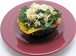 Quinoa, tomatoes, kale, and garlic-stuffed acorn squash