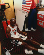USA MJ. Jordan lacing up the OG Olympic 7's before the big game.