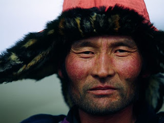 Excellent Photography image of Western Mangolian Man Wears a Fur-Trimmed Hat