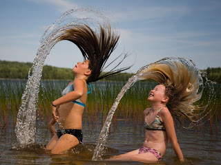 Beautiful Picture of two girls are at the Patten Pond in Maine