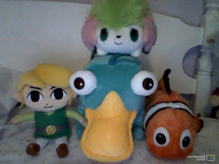 The Perry the Platypus plushie is new. :)