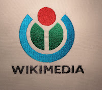 wikimedia logo and wikipedia annual report noticeletter