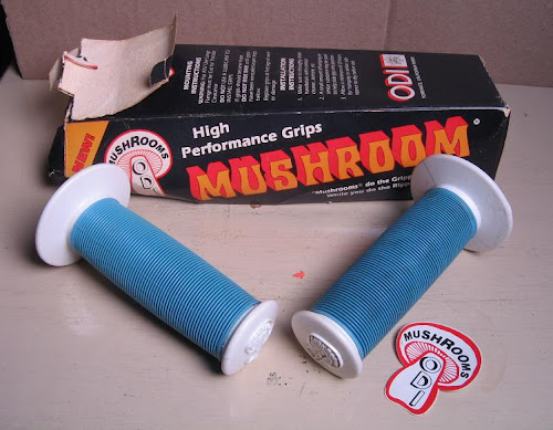 white and teal nos odi mushroom 2 bmx grips in box