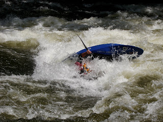 Kayaker being flipped at Lost Guide Rapid, Pigeon River